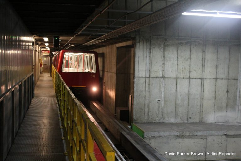 Below ground, one of the trains arrives at SEA